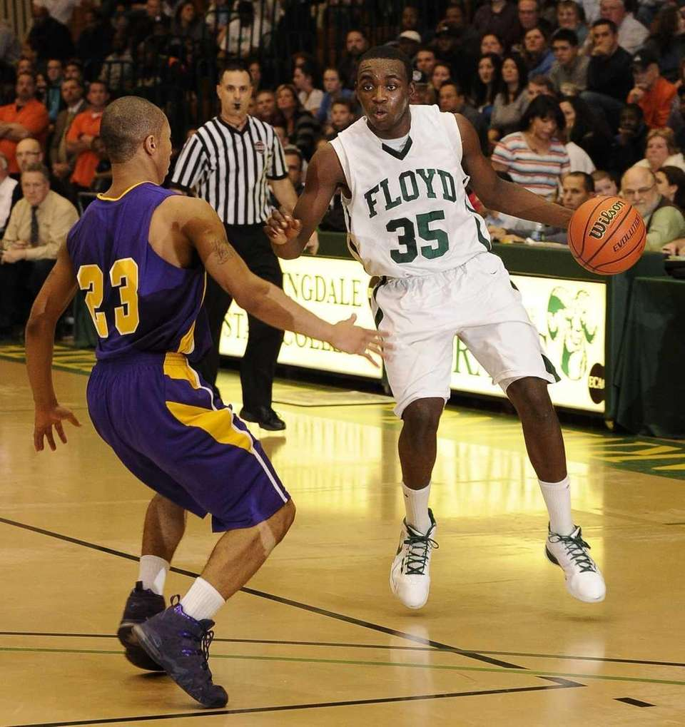 William Floyd guard Anthony White controls the ball
