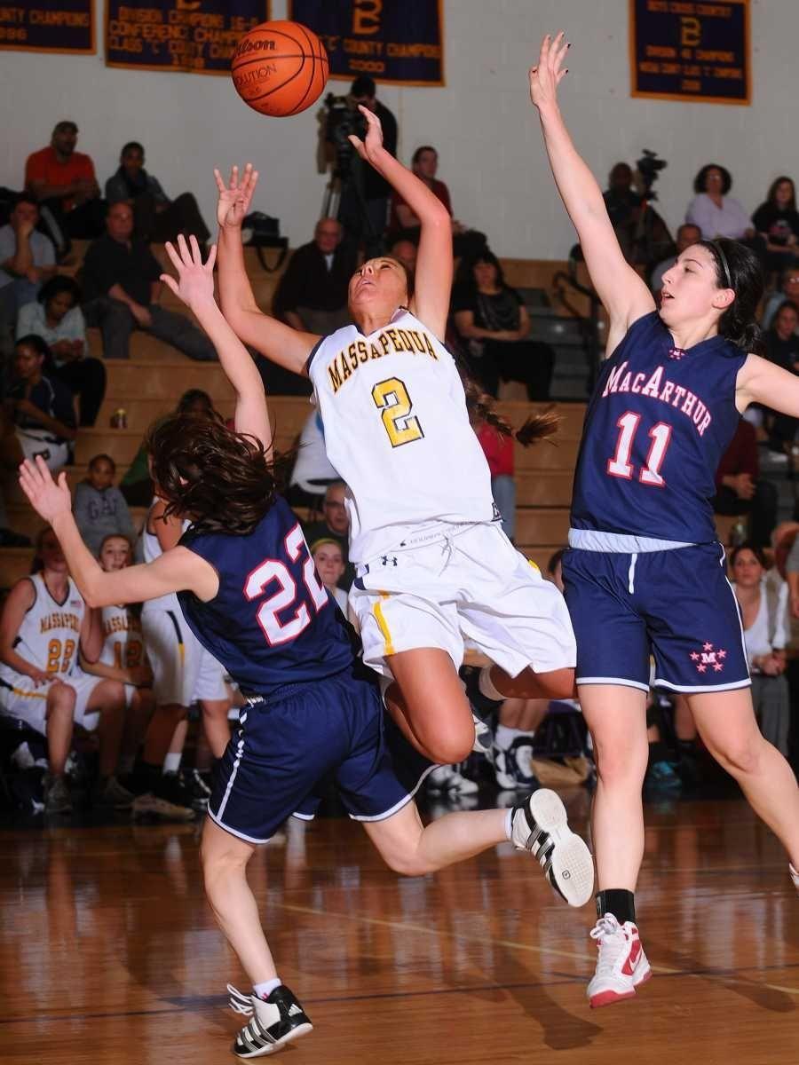 Massapequa High School #2 Danielle Doherty, center, looks