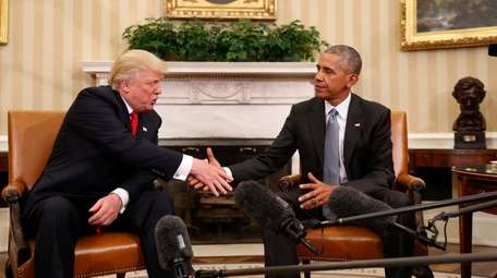 President Barack Obama shakes hands with then-President-elect Donald