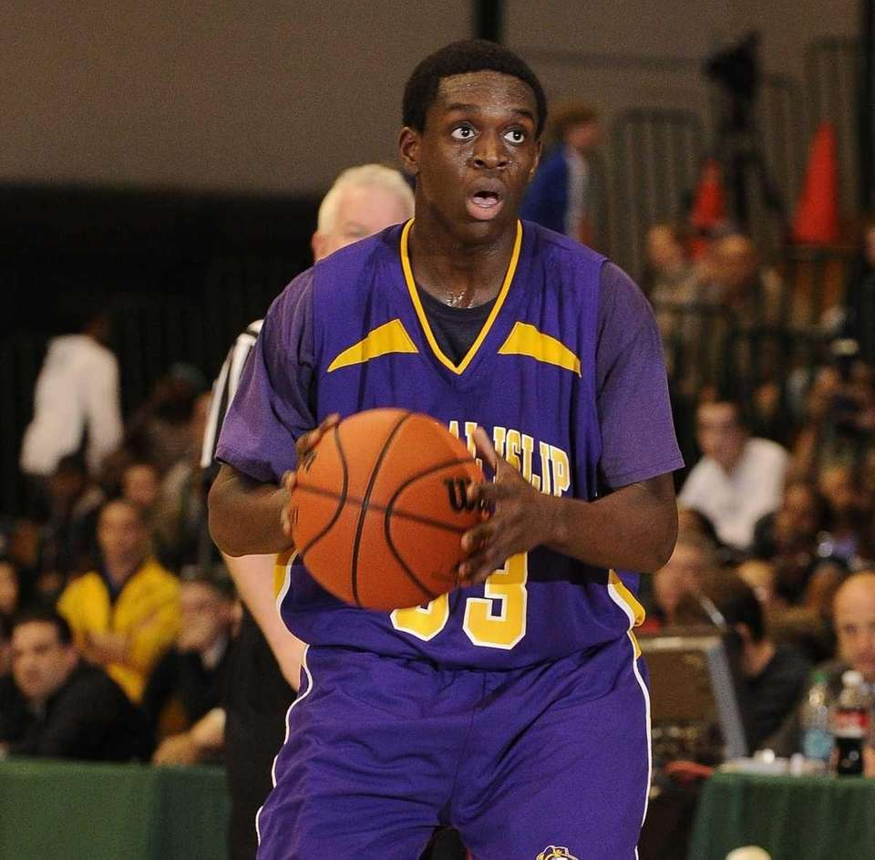 Central Islip's Jasean Percell looks to pass against