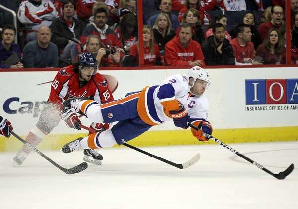 Mathieu Perreault of the Washington Capitals trips up