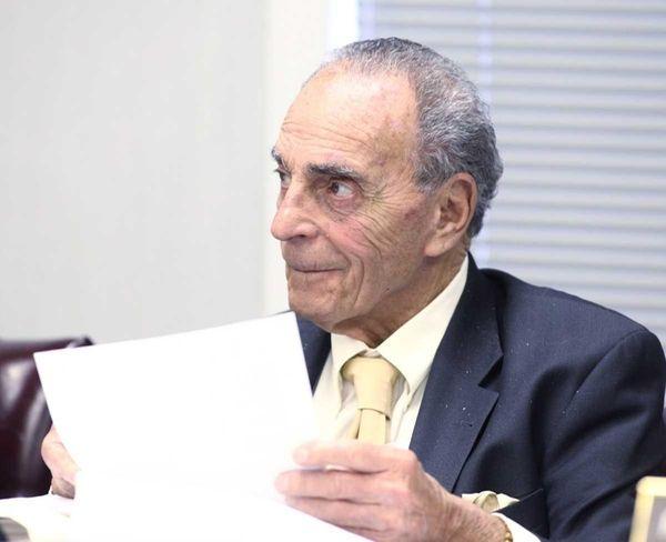 Smithtown Supervisor Patrick Vecchio listens during a town