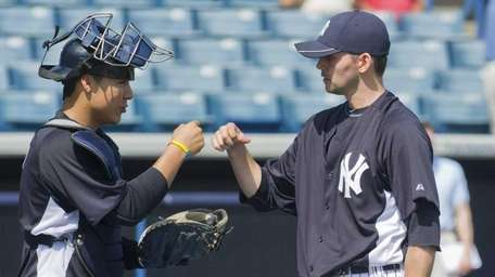 Yankees' pitcher Clay Rapada meets with catcher Jose