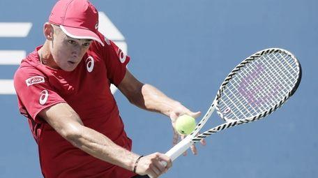 Alex de Minaur of Australia hits a return