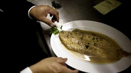The Dover Sole a la meuniere is plated