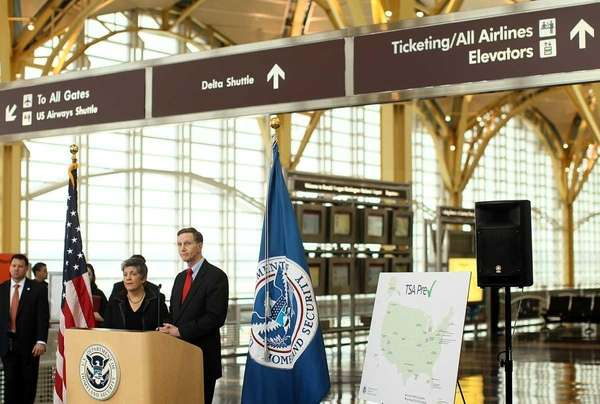 Transportation Security Administration administrator John Pistole (R) and