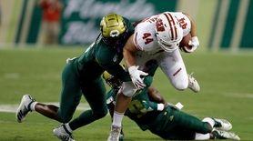 South Florida defensive backs Devin Studstill, left, and