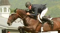 Shorapur and rider Kevin Babington compete at the