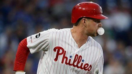 The Phillies' Rhys Hoskins runs after hittting a