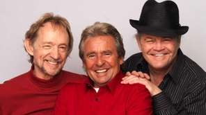 Left to right: Peter Tork, Davey Jones and