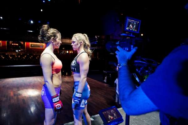 Strikeforce women's bantamweight champion Miesha Tate, left, and