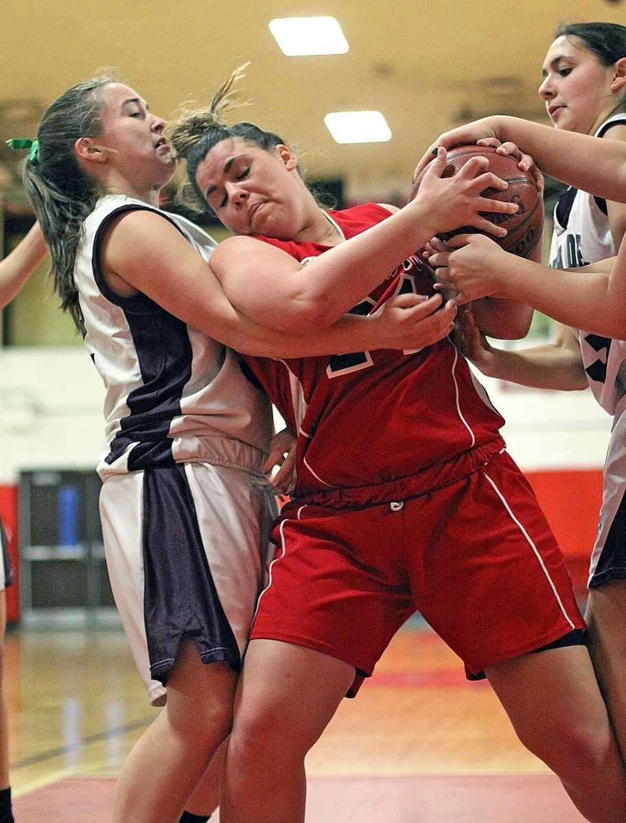 Floral Park's Emily Keenan works for ball against