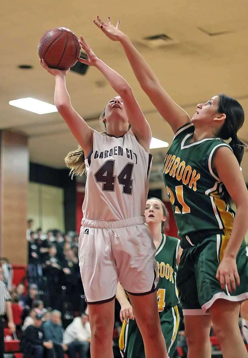 Garden City's Christina Mangels shoots over Danielle Amaya.