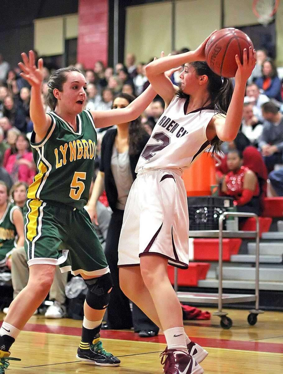 Garden City's Samantha Auricchio is covered by Lynbrook's
