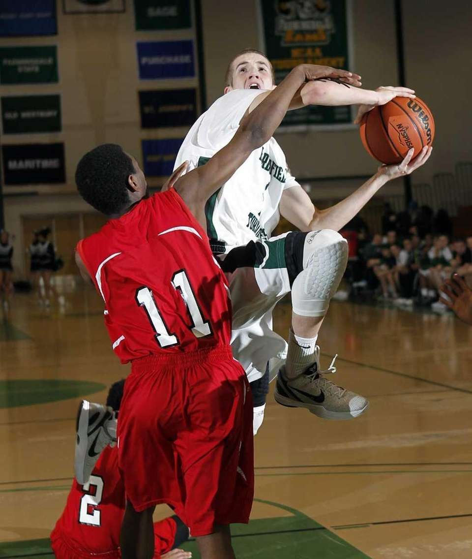 Harborfields' Lucas Woodhouse (1) draws the foul from