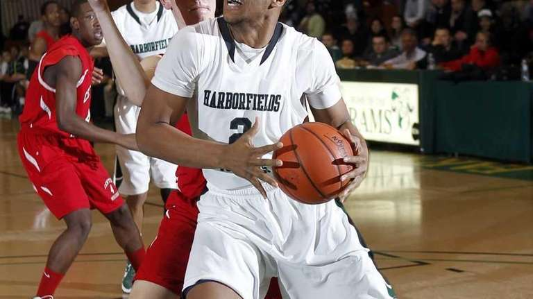 Harborfields' John Patron (2) drives into the paint