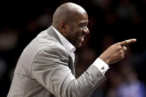 Hall of Famer Magic Johnson points toward the