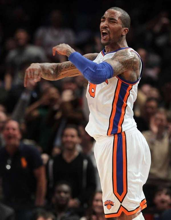 J.R. Smith celebrates after a dunk against the