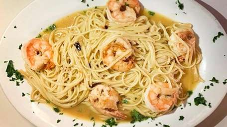 Scampi all'Remy features housemade taglierini and is finished