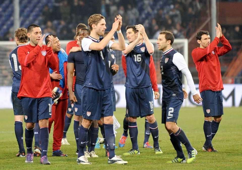 U.S. players celebrate at the end of a