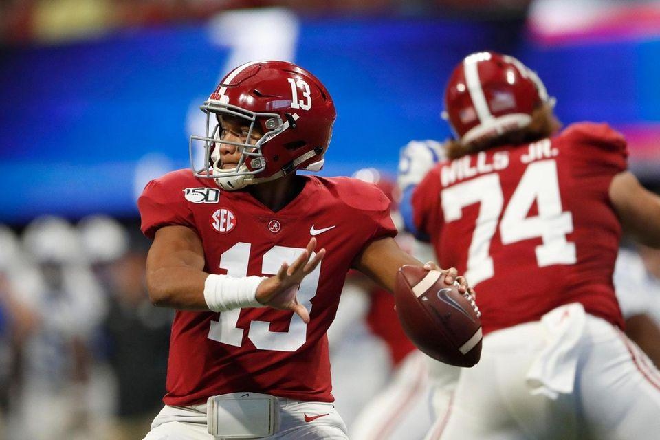 Alabama quarterback Tua Tagovailoa (13) throws from the