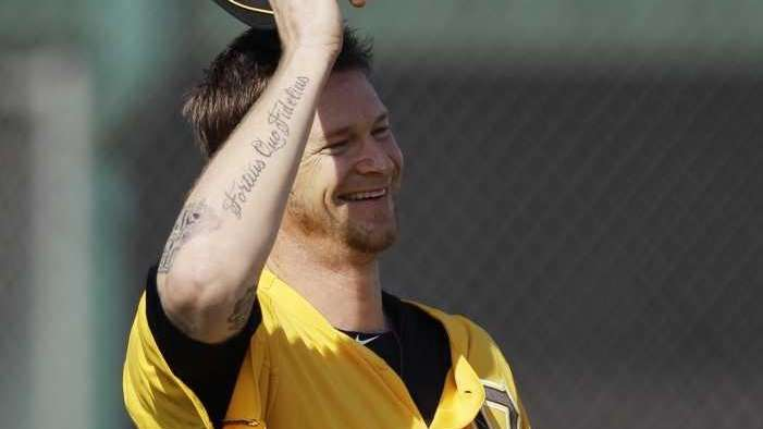Pittsburgh Pirates' A.J. Burnett laughs during practice at