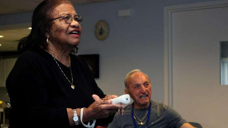 Central Islip resident Carrie Berry, 89, plays Wii
