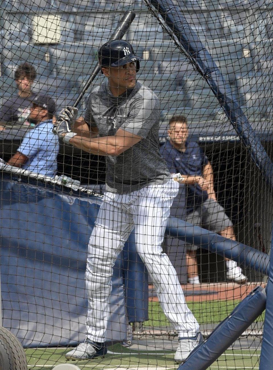 Injured Yankee Giancarlo Stanton of the Yankees taking