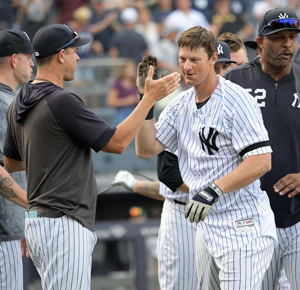 DJ LeMahieu is congratulated by Yankees Manager Aaron