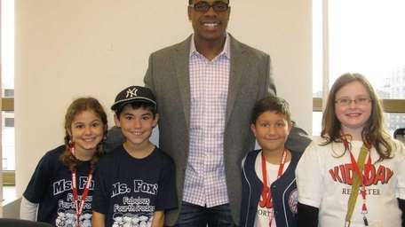 New York Yankees outfielder Curtis Granderson with Kidsday