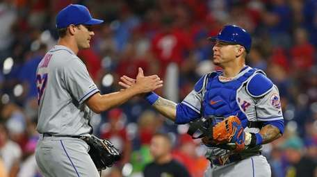 Seth Lugo #67 is congratulated by catcher Wilson