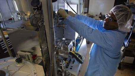 Ramon Garcia, electrical engineering manager, simulates working on