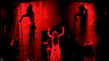 Molly Ranson, covered with blood-red light, in the