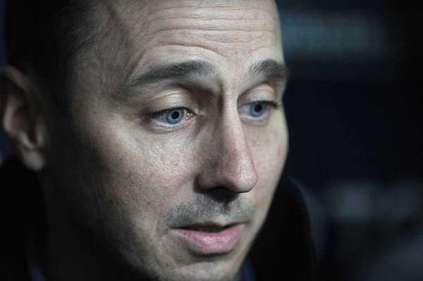 Yankees' general manager Brian Cashman talks to the