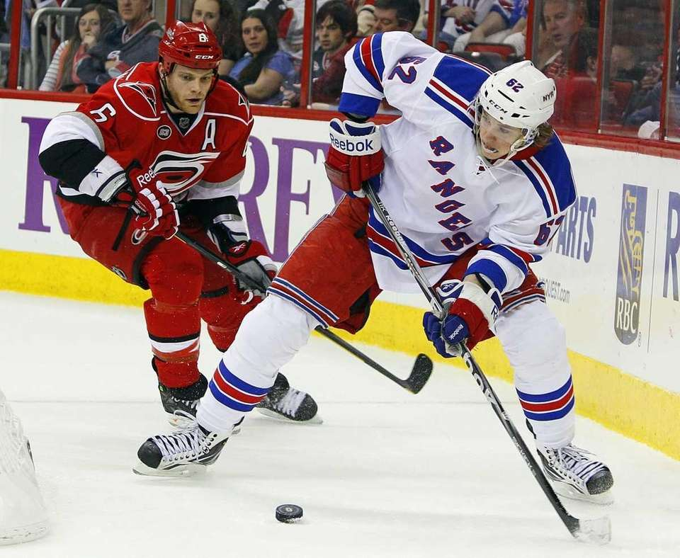 Rangers' Carl Hagelin works the puck behind the