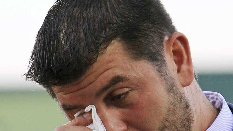 Boston Red Sox catcher Jason Varitek wipes a