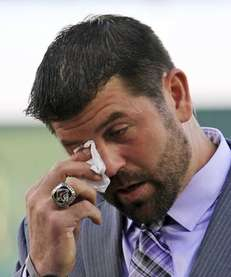 Boston Red Sox catcher Jason Varitek wipes a