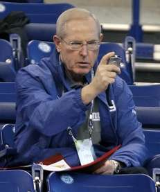 Giants head coach Tom Coughlin checks his stop