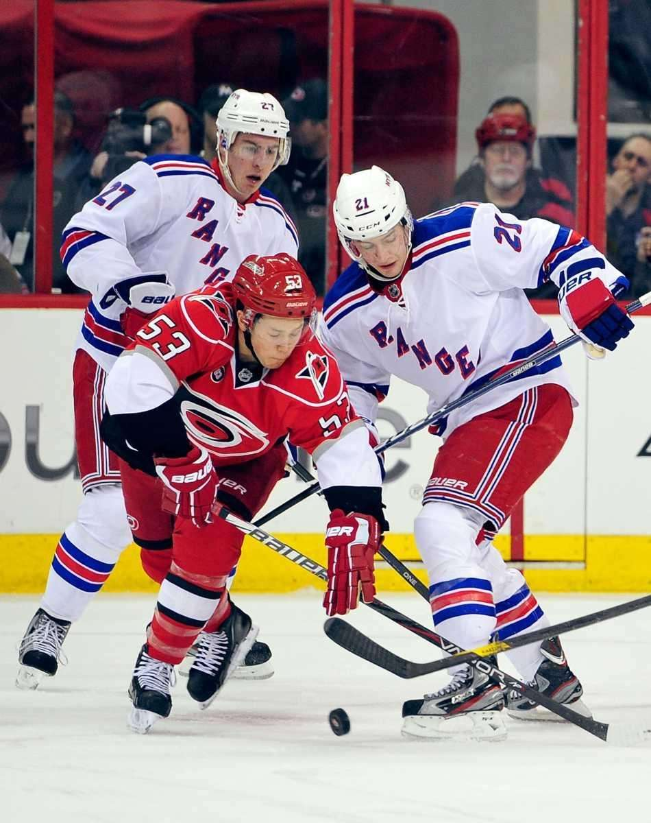Ryan McDonagh (27) and Derek Stepan (21) of