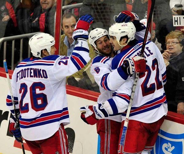 Rangers' Ruslan Fedotenko (26), Brandon Prust (8) and
