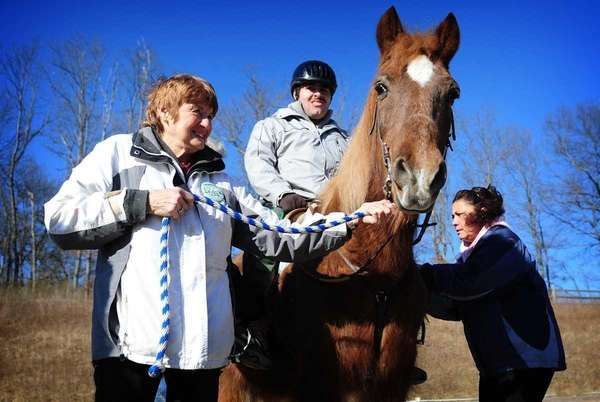 Linda Wigandt, a volunteer with HorseAbility (left) and