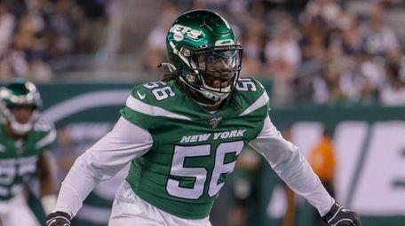 New York Jets linebacker Jachai Polite #56 drops