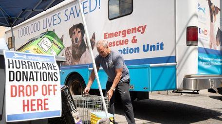 Stanley Santorelli of Whitestone, Queens, donates a pet