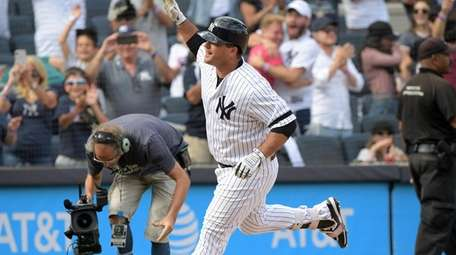 Mike Ford of the Yankees heading for home