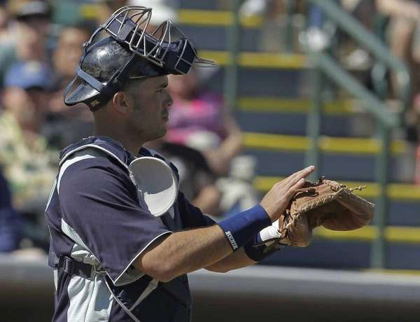 Seattle Mariners' Jesus Montero gives directions during the