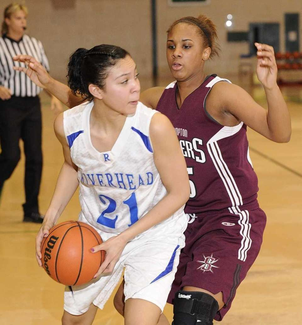 Riverhead forward Kaila-Riane Nazario looks to pass as