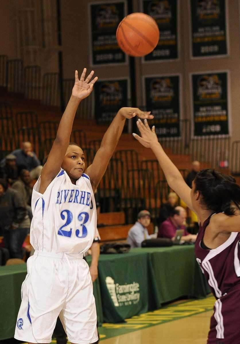 Riverhead guard Shanice Allen shoots a three-point shot