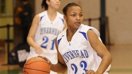 Riverhead guard Shanice Allen controls the ball against