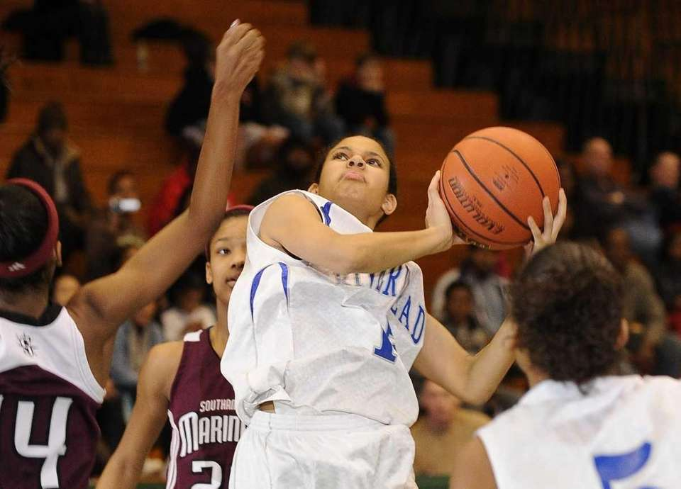 Riverhead guard Jalyn Brown goes up for a