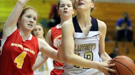 St. Anthony's Rebecca Musgrove looks to the basket